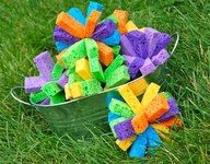 Sponge Bombs! MUCH better than water balloons; no refills or balloon pieces left behind. Plus very easy/cheap to make!  http://innerchildfun.com/2011/07/sponge-bomb-bucket-toss.html