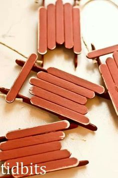 Popsicle stick sleigh Christmas tree ornaments.