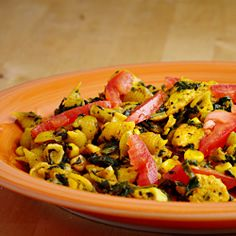 Classic vegan dish with spinach, pasta, sweet corn, and tomato.  Great for breakfast or dinner!