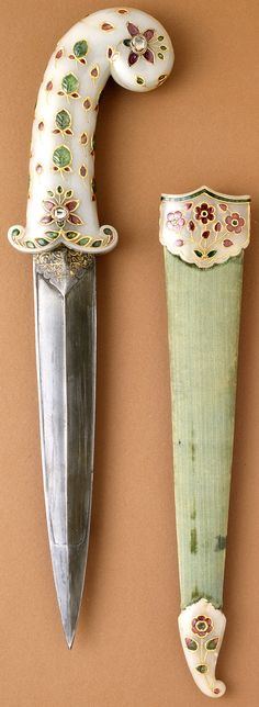 Indian dagger, Mughal empire, circa 1675-1700 (sheath fittings, circa 1800), white nephrite jade hilt and sheath fittings inlaid with foiled rubies, emeralds, and diamonds set in gold; steel blade; velvet covered wooden sheath overall: 16 7/8 x 3 x 1 in. (42.8625 x 7.62 x 2.54 cm) Sheath: 11 1/4 in. Dagger: 14 5/8 x 3 x 1 in. The Los Angeles County Museum of Art (LACMA). Swords And Daggers, Knives And Swords, Shadow Warrior, Dagger Knife, Mughal Empire, Arm Armor, Fantasy Weapons, Cold Steel, Ancient Artifacts