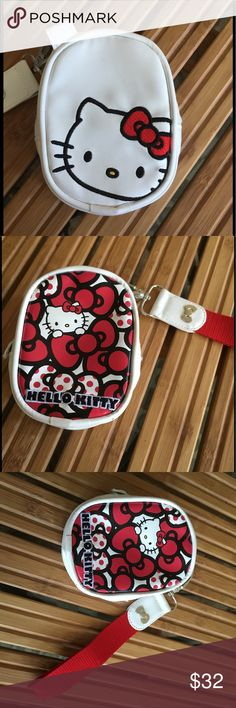Hello Kitty Wristlet Run and funky Wristlet in red, white and black has detachable strap with black and grey printed lining. Never used and in pristine condition. Bags Clutches & Wristlets