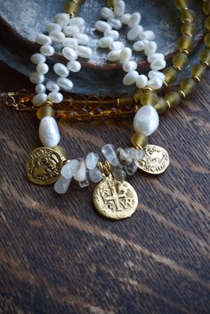 Pearls, coins and 16th century glamour! Luxury Elizabethan style jewelry feature in our 'Pirate Queen' collection for Spring by ThePillowBook - dreamy designer jewellery.