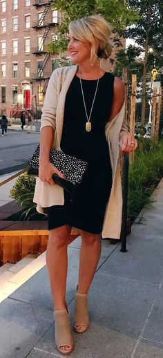 #winter #outfits beige cardigan; black sleeveless dress