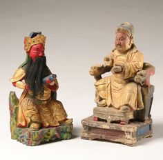 """Carved wooden Chinese temple figures; both with paint and gilt decoration, one with hair beard, chip carved and figural seats. Tallest 11 1/2""""H. Overpaint and surface wear on one deity."""