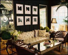 Black walls, animal prints, pops of emerald greenery