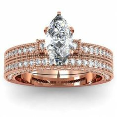 Marquise Milgrain Diamond Engagement Ring Wedding Set - A phenomenal combination for your love comes this 14k Rose Gold Marquise Milgrain Diamond Engagement Ring Wedding Set placed in a Micro Pave setting featuring a White Marquise Cut center stone set on the Milgrain edge with 78 White Round accent stones. The Marquise Milgrain engagement ring set is an SI1 in clarity with an E in color & the total gem weight is equal to 1.30 carats. All of the diamonds are 100% natural. #unusualengagementrings