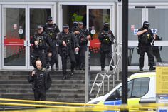 MANCHESTER, ENGLAND - OCTOBER 11: Armed police officers leave the Arndale Centre on October 11, 2019 in Manchester, England. A man in his 40s was arrested on suspicion of assault, as paramedics treated five people for injuries at Manchester Arndale, a large shopping complex in the city centre. (Photo by Anthony Devlin/Getty Images) via @AOL_Lifestyle