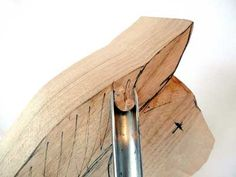 Using a number nine deep gouge cut the curve behind each ear around the back of the head...