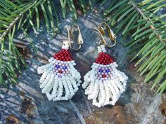 Santa Earrings in Brick Stitch  by Linda Jo Park  I was asked to teach a class on making little brick stitch Santa earrings. So I created th...