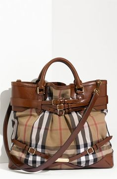 Free shipping and returns on Burberry Belted Check Print Bag at Nordstrom.com. An assortment of strappy leather belts corsets a slouchy, check-patterned handbag branded by a logo-engraved plate near the base. Rolled handles and an optional shoulder strap provide convenient carrying options.