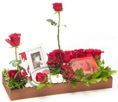 $61.60  Arreglo de rosas, con chocolates y tarjeta.
