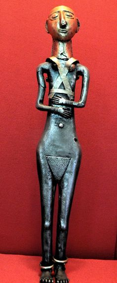 Standing Hittite female figurine. Her body is made from elektrum (an alloy of gold and silver), but the face mask, breast, anklets and bracelets are of pure gold, Anadolu Medeniyetleri Müzesi, Ankara, Turkey.