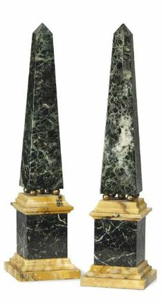 A PAIR OF VERDE ANTICO AND SIENA MARBLE OBELISKS SECOND HALF 20TH CENTURY Each raised on four brass balls above a stepped plinth 13 in. (33 cm.) high