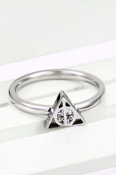 Triangle symbol design hers ring band. triangle symbol design hers ring band harry potter wedding Harry Potter Ring, Anillo Harry Potter, Harry Potter Schmuck, Bijoux Harry Potter, Harry Potter Items, Harry Potter Wedding, Harry Potter Fandom, Sapphire Jewelry, Blue Sapphire Rings