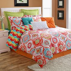 Liven up your bedroom with the bright and bold Fiesta Ava Reversible Comforter Set. Decorated with a medallion motif in hues of orange, blue, green and red, the colorful bedding instantly adds a pop of color to any room.