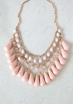 "My Baby Love Necklace 19.99 at shopruche.com. Drape your neck in elegance with this exquisite gold colored necklace perfected with faceted peach beads and hanging briolettes for a hint of light-catching shimmer.9"" long, Pendants: 7"" long, 2.5"" wide"