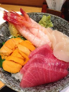 Kaisen-Don : a lice of several types of fish over vinegared rice.
