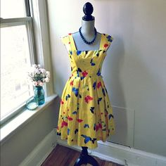 Beautiful Modcloth Butterfly Dress Butterflies dot this yellow silk dress from Modcloth! Boning in bodice and zip-up back. Like new condition! Missing original belt. Please note that this may not fit larger bust sizes. ModCloth Dresses Midi