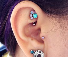 Rook Piercing Information and Inspiration Guide with 21 stunning rook piercing images. Information on rook piercing pain, healing, price, cleaning & care. Tragus Piercings, Rook Piercing Jewelry, Rook Jewelry, Ear Peircings, Rook Earring, Body Piercings, Piercing Tattoo, Jewellery, Crystal Earrings