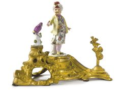 A LOUIS XV STYLE MEISSEN PORCELAIN-MOUNTED GILT BRONZE CENTERPIECE the porcelain 18th century, the gilt bronze late 19th century