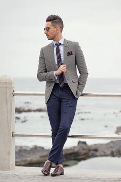 Gray blazer + striped tie + flower lapel + maroon pocket square + monk strap shoes