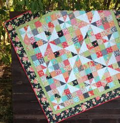 Pinwheels Over Patchwork (pattern by Carried Away Quilting)  small quilt (table topper or wall hanging). Featured fabric: Farmhouse by Fig Tree & Company for Moda.