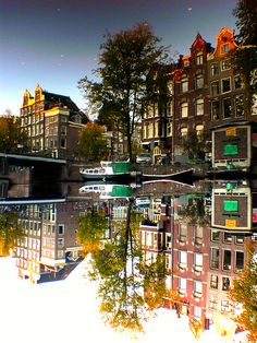Reflections Of Amsterdam - Clarity -  Typical Amsterdam houses, reflected in a canal...by AmsterSam - The Wicked Reflectah, via Flickr