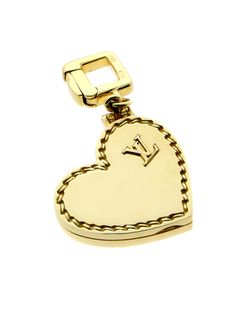 It's often said that the most passionate of lovers always wear their hearts on their sleeves, but when it comes to this 18k Yellow Gold Heart Locket Charm Pendant by Louis Vuitton, it might be more accurate to say that they wear it on their Charm Bracelet or Necklace! With both an iconic LV monogram and an intricate garnish design within the borders of the Heart itself, this Pendant really is a girl's best friend.