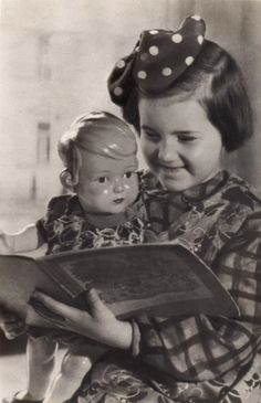 Vintage photo of little girl with her Inge doll.
