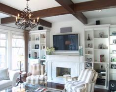 chair placement with the fireplace, bookshelves