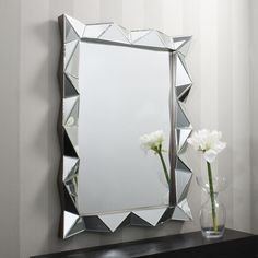 """peering at herself in the mirror, absorbed in trying to tie it-"" Actual mirror may not be as decorated as this."
