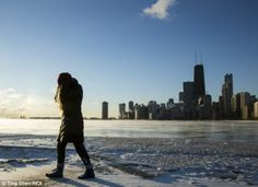 Frozen: A girl walks by frozen Lake Michigan in Chicago as the Midwest remains blanketed in ice