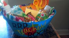 Great teachers gift!  A simply plastic basket (can get them from the dollar store!) personalized with vinyl from your cricut and filled with school supplies and candy.  This one has glue, kleenex, scissors, crayons, post-its, hand sanitizer and candy.  What teacher would not want some help with getting supplies?  :)