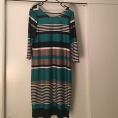 KNEE LENGTH STRETCHY DRESS PURCHASED FROM JC PENNEY IN THE MISSES DRESS DEPT. LOVE LOVE LOVE THE STRETCH. I'M 5'9 & IT DROPS A LITTLE BELOW MY KNEES. WORN ONCE BUT YOU'D NEVER KNOW Dresses Midi