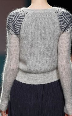 could easily make this fair isle.  fun!  fair isle on just the sleeves.  that would mean seaming and wrong side fair isle-ing, or knitting two sleeves together and steeking?