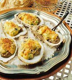 Oysters smothered in a white wine sauce chock-full of shrimp and mushrooms, then topped with Parmesan crumbs, makes this a rich treat. When buying fresh oysters, look for those with tightly closed shells and a fresh scent (not a strong fishy odor). Oyster Recipes, Cajun Recipes, Fish Recipes, Seafood Recipes, Appetizer Recipes, Cooking Recipes, Cooking Tips, Appetizer Dishes, Cajun Food
