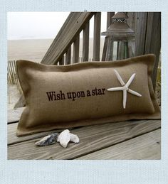 "Beach Pillow. ""Wish upon a star"". Woven from the finest grade of soft jute burlap and skillfully tailored by hand, in the Carolinas. Natural starfish is stitched by hand, using nubby twine. Each is hand-made with love and pride."
