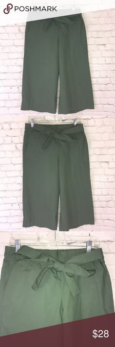 J crew green gaucho pants J crew green gaucho pants with attached belt that can be tied in the front side or back.  Gaucho has elastic waist Machine wash cold Length 30' Waist flat 16' Inseam 19' J. Crew Pants Ankle & Cropped