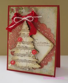 Grunged Christmas Tree Card...with music sheet paper, lace paper doily, & buttons.