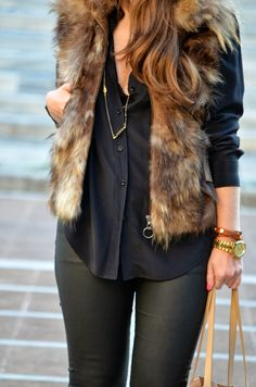 Faux fur vest, black silk blouse, and black leather leggings