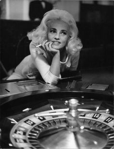 """Jeanne Moreau in the Casino de Monte-Carlo, from Jacques Demy's """"La Baie des Anges,"""" The Photographs That Helped """"Breathless"""" Start a Revolution - The New Yorker Jeanne Moreau, Jacques Demy, Bertrand Blier, Francois Truffaut, French New Wave, The New Wave, Women Smoking, Girl Smoking, French Actress"""