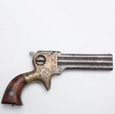 WILLIAM MARSTON'S THREE-SHOT PISTOL: Marston began marketing before the American Civil War a three-shot handgun in .22 rimfire, with some examples also incorporating a sliding dagger blade on the side of the superimposed barrels. It is estimated that less than five hundred guns with the retractable blade were made, but purchasers could select either a Bowie or a spear-point blade for their pistol. The firing indicator on the side of the receiver showed which barrel was next in sequence.