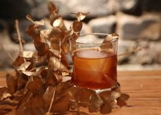Cinnamon-spiced pear whiskey forms the base of this wintery twist on an old fashioned.