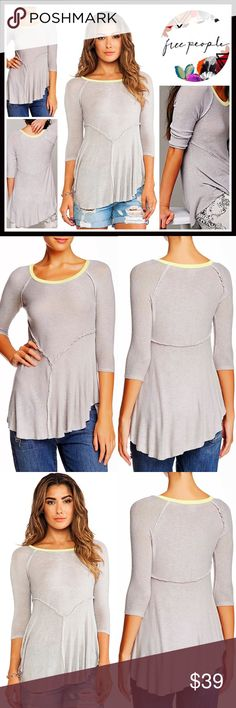 """⭐️⭐️ FREE PEOPLE Tunic Knit Swing Layering Tee 💟NEW WITH TAGS💟 FREE PEOPLE Tunic Swing Layering Tee  DETAILS:   * Scoop neck  * 3/4 length sleeves  * Contrast trim & asymmetrical cape hem  * Approx 24-32"""" long, hi-lo style  * Super soft lightweight fabric  * Stretch-to-fit style   Color: Dove Grey Combo Fabric: 95% rayon & 5% spandex Item#: T shirt marled 🚫No Trades🚫 ✅ Offers Considered*✅ *Please use the blue 'offer' button to submit an offer Free People Tops Tunics"""