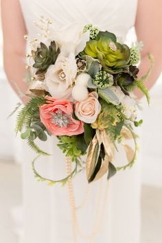 silk flower bouquet with brooches - photo by Cannon Candids Photography http://ruffledblog.com/coral-and-emerald-wedding-inspiration #weddingbouquet #silkflowers #bouquets