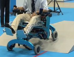 a new wheelchair that has the ability to climb over obstacles and turn in tight spaces.