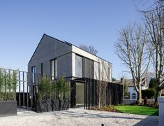 One of two grey brick house with steel pergola Dublin Grey Brick Houses, Steel Pergola, Dublin, Garage Doors, Contemporary, Outdoor Decor, Beautiful, Design, Home Decor