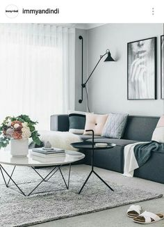 Table Living Room. A modern gray neutral living room with a touch of pink  byTHERS button cushion from cozy and family home punctuated earth tone accents