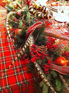 Tartan and pheasant feathers in the table centerpiece makes for an elegant and dramatic holiday look Design Maze: The Bay: Christmas Edition