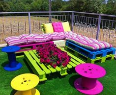 Colorful lounge furniture from wooden pallets & spools.